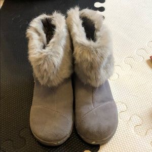 Tom's fur boots